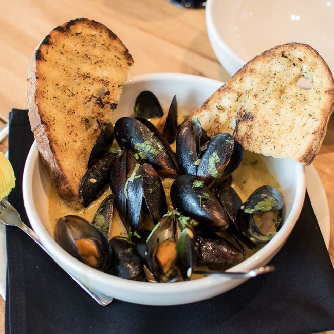 Coconut Curry Mussels at Bonfyre American Grille