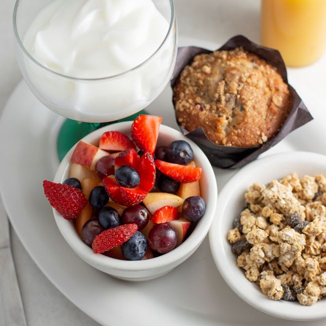 Granola served with fruit and muffin  at Mike's Port Pub & Grill