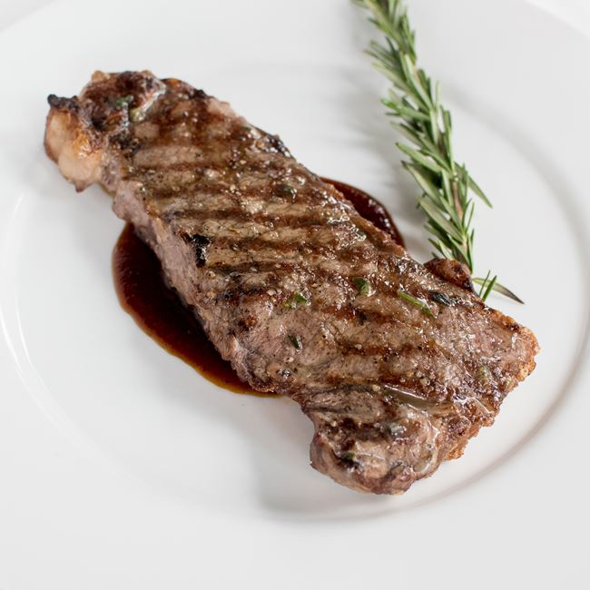 12 oz New York Strip at Johnny Delmonico's Steakhouse