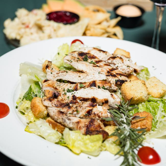 Grilled Chicken Caesar Salad at Norwood Pines Supper Club