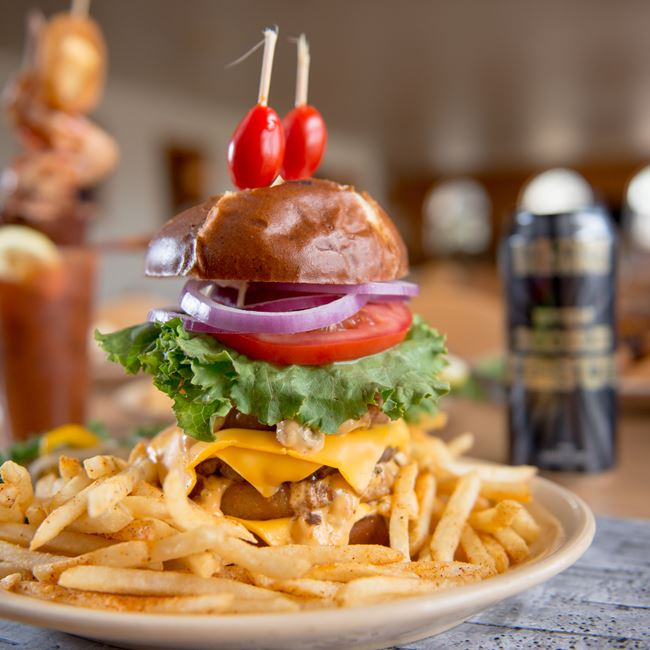The Gut Buster Burger at Samuelson's Creek Pub And Grill