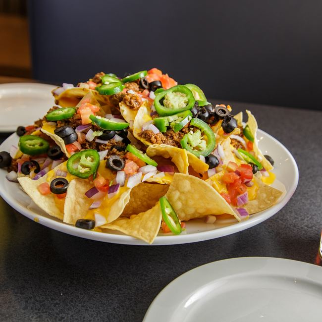 Deluxe Nachos at Monk's Bar & Grill
