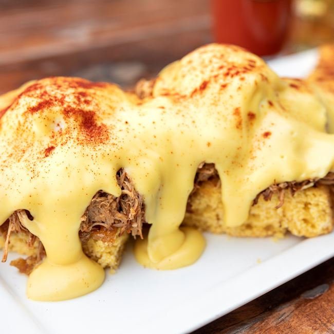 Pulled Pork Eggs Benedict at Chester V's