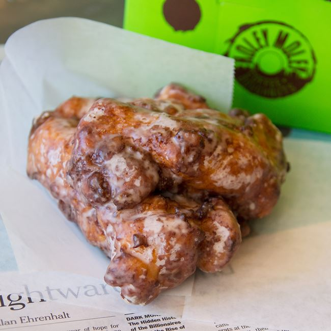 Apple Cinnamon Fritter at Holey Moley Coffee and Doughnuts