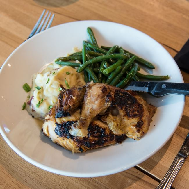 Herb Rotisserie Chicken at Bonfyre American Grille