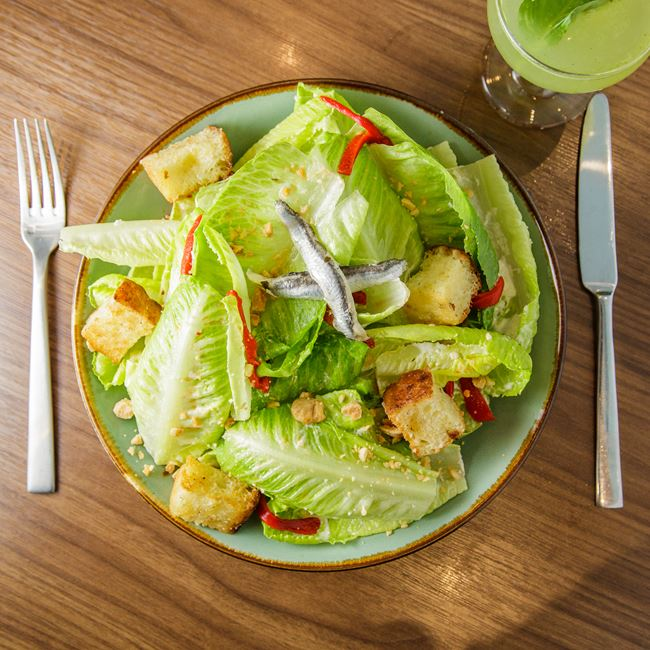 Spanish Caesar Salad at The Corner Office Restaurant + Martini Bar