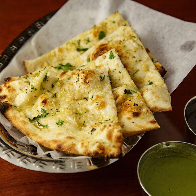 Garlic Naan at OM Indian Fusion Cuisine