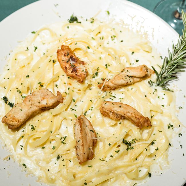 Pasta Alfredo with Sauteed Chicken at Norwood Pines Supper Club