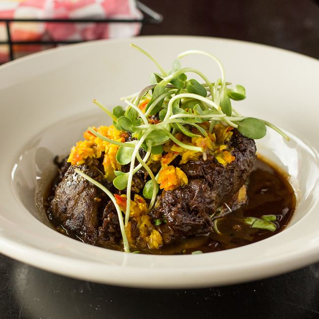 Abita Beer-Braised Duroc Pork Cheeks at Maxie's